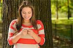 Woman using cell phone in park Stock Photo - Premium Royalty-Free, Artist: Blend Images, Code: 614-06625376