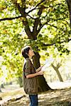 Woman reading map in park Stock Photo - Premium Royalty-Free, Artist: Cultura RM, Code: 614-06625379