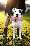 Man holding dog in park Stock Photo - Premium Royalty-Free, Artist: Cultura RM, Code: 614-06625424