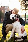 Man hugging dog in park Stock Photo - Premium Royalty-Free, Artist: CulturaRM, Code: 614-06625427