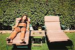 Woman in bikini sunbathing in lawn chair Stock Photo - Premium Royalty-Free, Artist: Aflo Relax, Code: 614-06625472