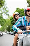 Couple riding scooter together Stock Photo - Premium Royalty-Free, Artist: Cultura RM, Code: 6113-06625573