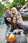 Friends smiling on scooter outdoors Stock Photo - Premium Royalty-Free, Artist: AWL Images, Code: 6113-06625612