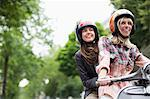 Women riding on scooter together outdoors Stock Photo - Premium Royalty-Free, Artist: Cultura RM, Code: 6113-06625627