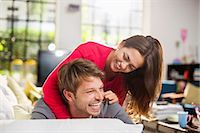 Couple playing together on sofa Stock Photo - Premium Royalty-Freenull, Code: 6113-06625655