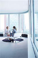Businesswomen talking in office lobby Stock Photo - Premium Royalty-Freenull, Code: 6113-06625819