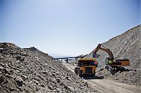 piles of work - Machinery at work in quarry Stock Photo - Premium Royalty-Freenull, Code: 6113-06625872