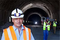 pipe (industry) - Businessman standing in tunnel Stock Photo - Premium Royalty-Freenull, Code: 6113-06625887