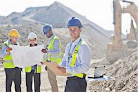 Businessmen reading blueprints in quarry Stock Photo - Premium Royalty-Freenull, Code: 6113-06625894