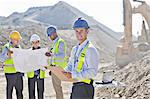 Businessmen reading blueprints in quarry Stock Photo - Premium Royalty-Free, Artist: Robert Harding Images, Code: 6113-06625894