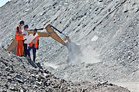 Workers and businessman talking in quarry Stock Photo - Premium Royalty-Freenull, Code: 6113-06625908