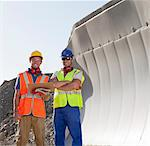 Workers smiling by machinery in quarry Stock Photo - Premium Royalty-Free, Artist: Kablonk! RM, Code: 6113-06625918