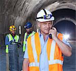 Businessman using walkie-talkie in tunnel Stock Photo - Premium Royalty-Free, Artist: Blend Images, Code: 6113-06625948