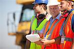 Businessman and workers talking on site Stock Photo - Premium Royalty-Free, Artist: Kablonk! RM, Code: 6113-06625957