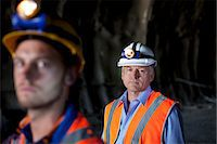 Businessman and worker standing in tunnel Stock Photo - Premium Royalty-Freenull, Code: 6113-06625969