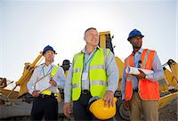 Businessmen in hard hats standing on site Stock Photo - Premium Royalty-Freenull, Code: 6113-06625970