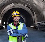 Worker standing in tunnel Stock Photo - Premium Royalty-Free, Artist: CulturaRM, Code: 6113-06625972