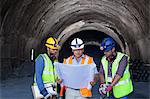 Workers and businessman with blueprints in tunnel Stock Photo - Premium Royalty-Free, Artist: Kablonk! RM, Code: 6113-06625975