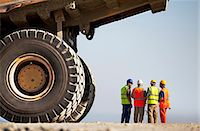 Workers talking by machinery on site Stock Photo - Premium Royalty-Freenull, Code: 6113-06625983