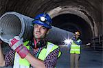 Workers carrying long pipe in tunnel Stock Photo - Premium Royalty-Free, Artist: Kablonk! RM, Code: 6113-06625984