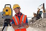 Worker using leveling equipment in quarry Stock Photo - Premium Royalty-Free, Artist: Transtock, Code: 6113-06625985