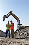 Workers talking by digger in quarry Stock Photo - Premium Royalty-Free, Artist: Robert Harding Images, Code: 6113-06625990