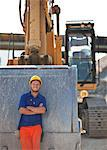 Worker standing by digger on site Stock Photo - Premium Royalty-Free, Artist: Raimund Linke, Code: 6113-06625993