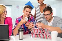 piles of work - Business people making house of cards in office Stock Photo - Premium Royalty-Freenull, Code: 6113-06626027