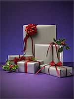present wrapped close up - Stack of wrapped Christmas presents Stock Photo - Premium Royalty-Freenull, Code: 6113-06626090