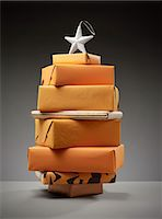 present wrapped close up - Stack of wrapped Christmas presents Stock Photo - Premium Royalty-Freenull, Code: 6113-06626097