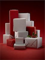 present wrapped close up - Stack of wrapped Christmas presents Stock Photo - Premium Royalty-Freenull, Code: 6113-06626099