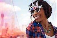 Woman wearing novelty sunglasses on city street Stock Photo - Premium Royalty-Freenull, Code: 6113-06626118