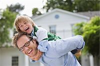 father with two sons not girls - Man carrying son piggyback outdoors Stock Photo - Premium Royalty-Freenull, Code: 6113-06626320
