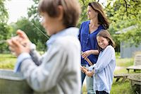 fishing - Family fishing together Stock Photo - Premium Royalty-Freenull, Code: 6113-06626322