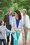 Family walking on rural road