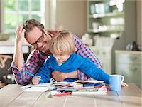 father with two sons not girls - Father and son doing homework at kitchen table Stock Photo - Premium Royalty-Freenull, Code: 6113-06626377