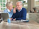 Couple using laptop at kitchen table Stock Photo - Premium Royalty-Free, Artist: Uwe Umstätter, Code: 6113-06626398