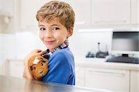 Boy holding guinea pig in vet's surgery Stock Photo - Premium Royalty-Freenull, Code: 6113-06626491
