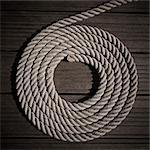 Rope coiled into circle on boardwalk Stock Photo - Premium Royalty-Free, Artist: photo division, Code: 6113-06626626