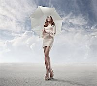sandi model - Woman in white standing with a white umbrella in a fake desert Stock Photo - Royalty-Freenull, Code: 400-06628917
