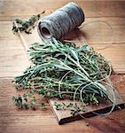 Bunch of fresh thyme and rosemary on wooden board Stock Photo - Royalty-Free, Artist: barol16                       , Code: 400-06633471