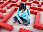 Sad girl sits in a labyrinth with red walls Stock Photo - Royalty-Free, Artist: FotoVika                      , Code: 400-06638982