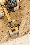 Working Excavator Tractor Digging A Trench. Stock Photo - Royalty-Free, Artist: Feverpitched                  , Code: 400-06639572