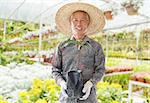 Asian Chinese farmer holding a young plant in green house Stock Photo - Royalty-Free, Artist: szefei                        , Code: 400-06643515