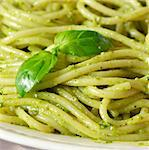 Italian pasta spaghetti with pesto sauce and basil leaf close-up. Stock Photo - Royalty-Free, Artist: lidante                       , Code: 400-06644367