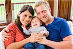 Portrait of Couple Holding Their Three Month Old Son Stock Photo - Premium Rights-Managed, Artist: Jim Craigmyle, Code: 700-06645601