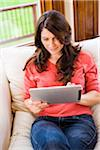 Woman Using iPad at Home Stock Photo - Premium Rights-Managed, Artist: Jim Craigmyle, Code: 700-06645602