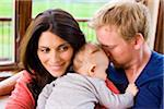 Couple Hugging and Snuggling with Three Month Old Son Stock Photo - Premium Rights-Managed, Artist: Jim Craigmyle, Code: 700-06645606