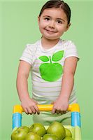 Girl with apples in shopping trolley Stock Photo - Premium Royalty-Freenull, Code: 6114-06645958