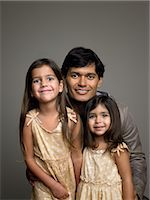 Father and daughters Stock Photo - Premium Royalty-Freenull, Code: 6114-06646132